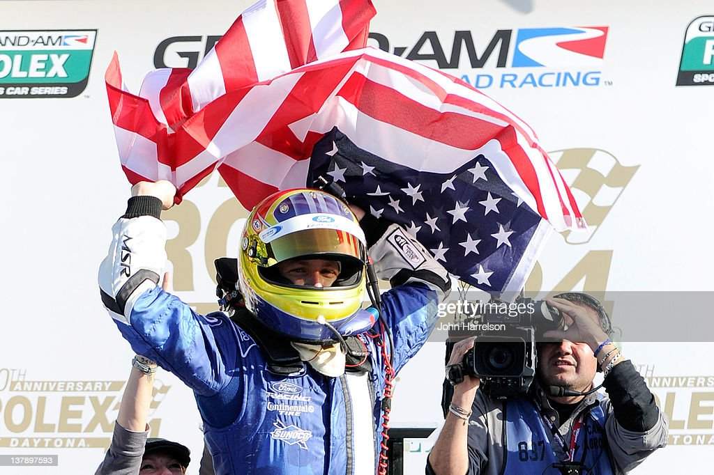 AJ Allmendinger driver of the #60 DP Michael Shank Racing Ford Riley celebrates in Victory Lane after winning the Rolex 24 at Daytona International Speedway on January 29, 2012 in Daytona Beach, Florida.