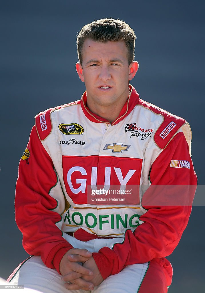 AJ Allmendinger, driver of the #51 Guy Roofing Chevrolet, sits on the wall during qualifying for the NASCAR Sprint Cup Series Subway Fresh Fit 500 at Phoenix International Raceway on March 1, 2013 in Avondale, Arizona.