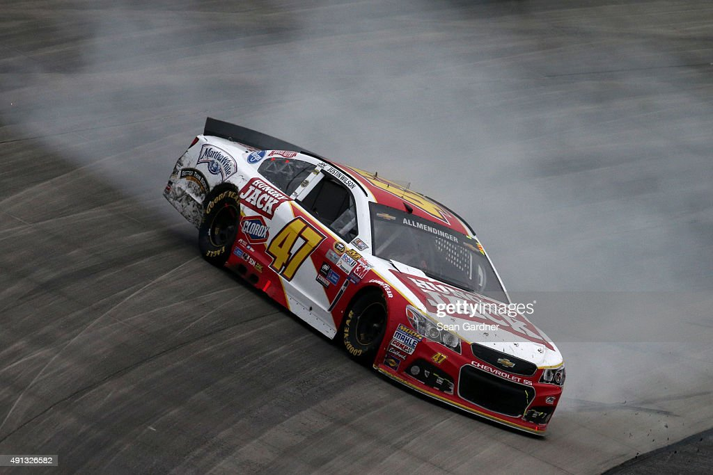 AJ Allmendinger, driver of the #47 Hungry Jack Chevrolet, spins during the NASCAR Sprint Cup Series AAA 400 at Dover International Speedway on October 4, 2015 in Dover, Delaware.