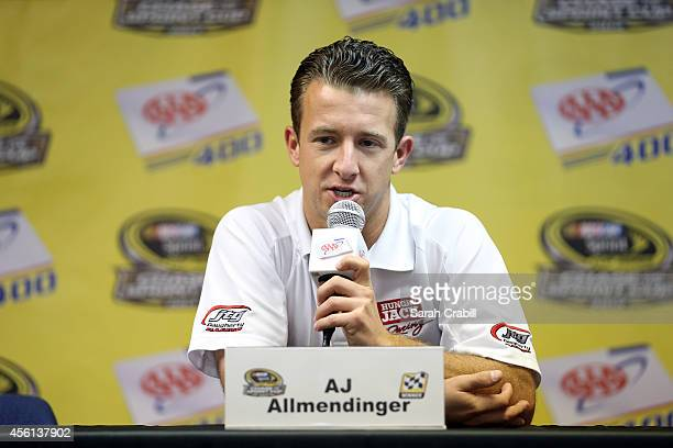 J Allmendinger driver of the Hungry Jack/ACME Chevrolet speaks to the media prior to practice for the NASCAR Sprint Cup Series AAA 400 at Dover...