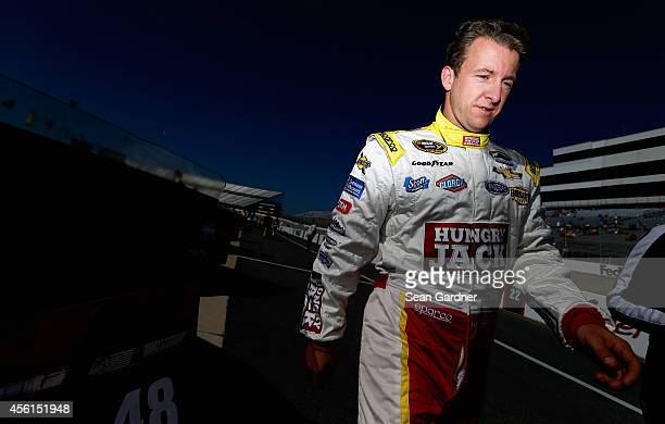 J Allmendinger driver of the Hungry Jack/ACME Chevrolet walks on pit road during qualifying for the NASCAR Sprint Cup Series AAA 400 at Dover...
