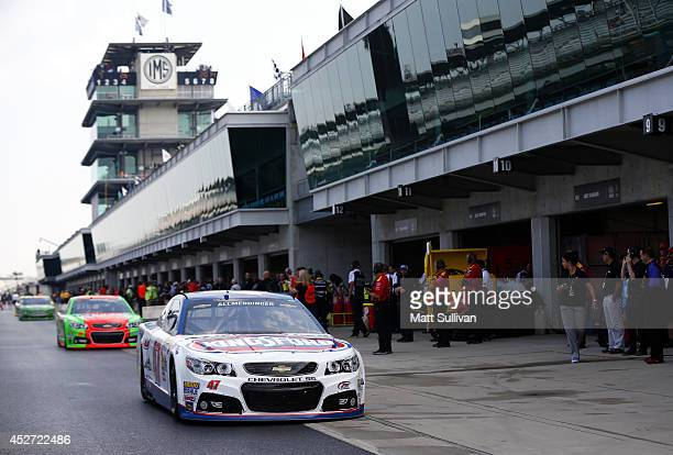 Allmendinger driver of the Kingsford Charcoal Chevrolet drives through the garage area during practice for the NASCAR Sprint Cup Series Crown Royal...