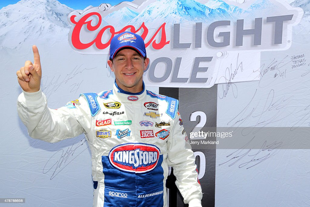 AJ Allmendinger, driver of the #47 Kingsford Charcoal Chevrolet, poses in front of the Coors Light Pole Award board after qualifying for pole position for the NASCAR Sprint Cup Series Toyota/Save Mart 350 at Sonoma Raceway on June 27, 2015 in Sonoma, California.