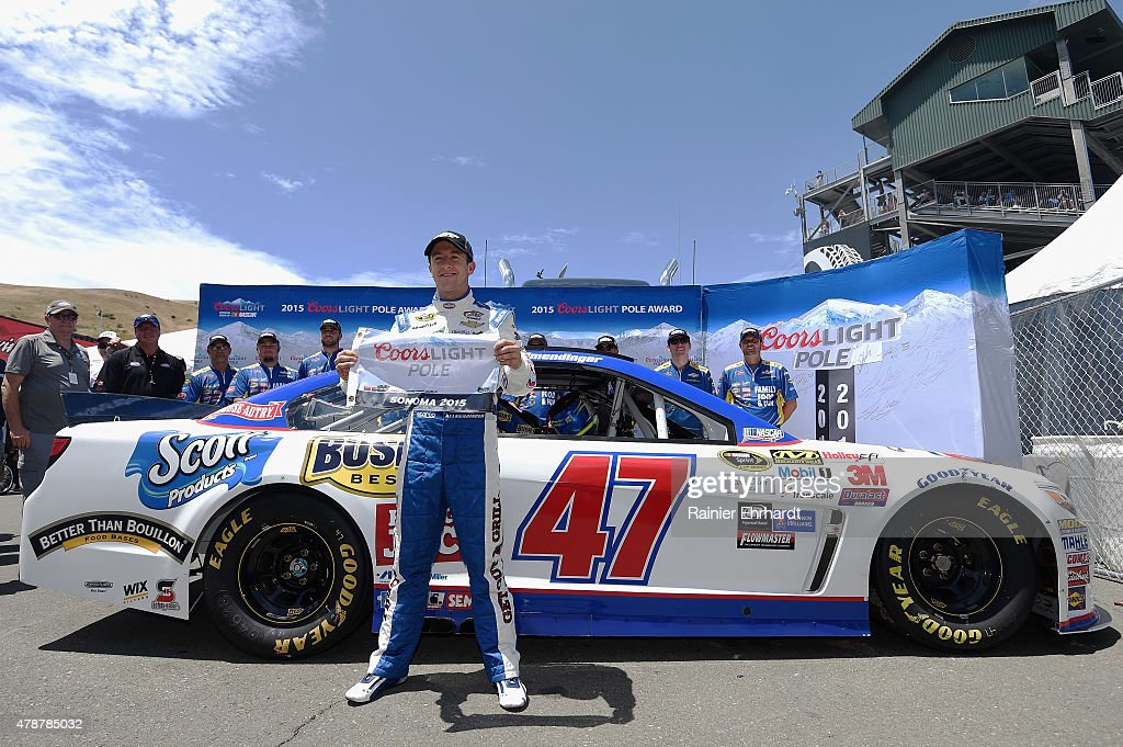 AJ Allmendinger, driver of the #47 Kingsford Charcoal Chevrolet, poses with the Coors Light Pole Award after qualifying for pole position for the NASCAR Sprint Cup Series Toyota/Save Mart 350 at Sonoma Raceway on June 27, 2015 in Sonoma, California.