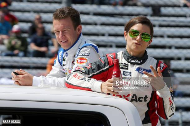Allmendinger driver of the Kroger ClickList Chevrolet and Danica Patrick driver of the TaxAct Ford looks on before the Monster Energy NASCAR Cup...