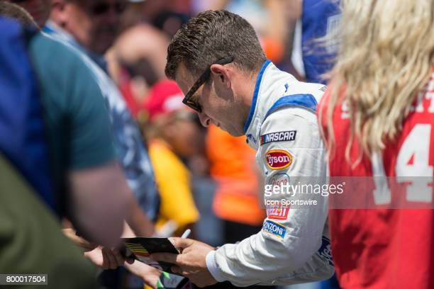 Allmendinger driver of the Kroger ClickList Chevrolet greets fans during the driver introductions ceremony prior to the start of the Monster Energy...