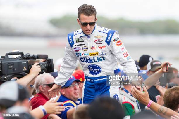 Allmendinger driver of the Kroger ClickList Chevrolet greets fans during the prerace ceremonies of the Monster Energy NASCAR Cup Series Pure Michigan...
