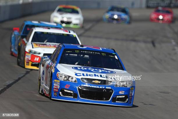 Allmendinger driver of the Kroger ClickList Chevrolet leads a pack of cars during the Monster Energy NASCAR Cup Series AAA Texas 500 at Texas Motor...