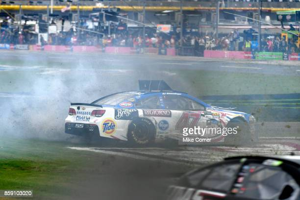 Allmendinger driver of the Kroger ClickList Chevrolet spins during the Monster Energy NASCAR Cup Series Bank of America 500 at Charlotte Motor...