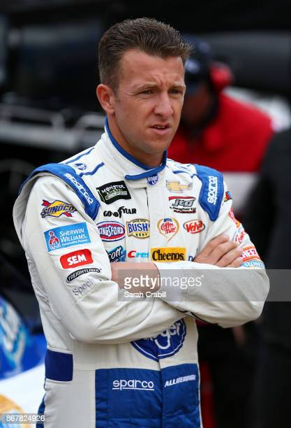 Allmendinger driver of the Kroger ClickList Chevrolet stands on the grid before qualifying for the Monster Energy NASCAR Cup Series First Data 500 at...