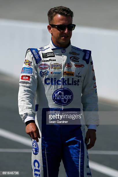 J Allmendinger driver of the Kroger ClickList Chevrolet walks down pit road during qualifying for the Monster Energy NASCAR Cup Series AAA 400 Drive...