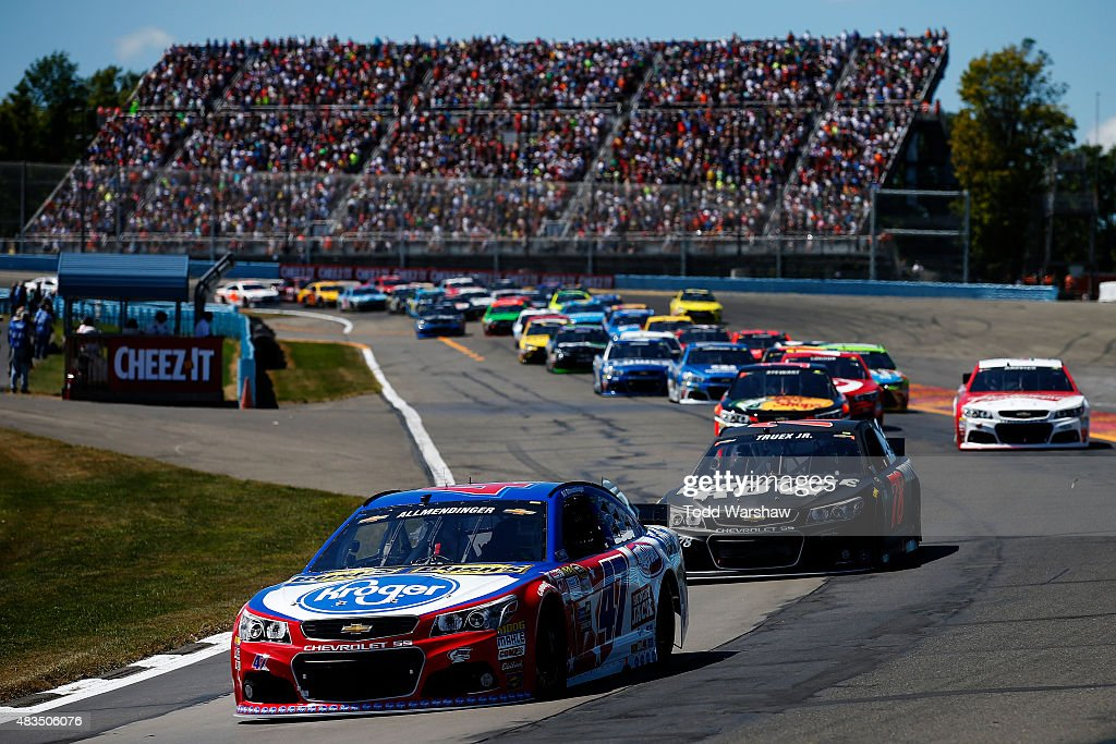 Allmendinger driver of the Kroger/Bush's Beans Chevrolet leads the field at the start of the NASCAR Sprint Cup Series CheezIt 355 at the Glen at...