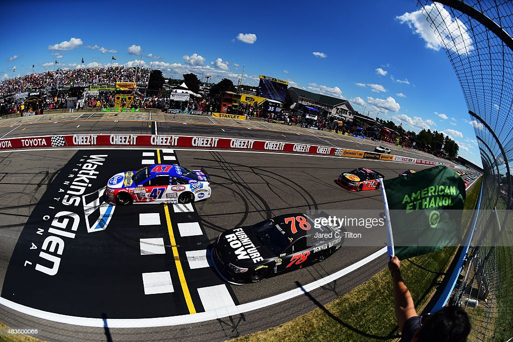 AJ Allmendinger, driver of the #47 Kroger/Bush's Beans Chevrolet, leads the field through the green flag to start the NASCAR Sprint Cup Series Cheez-It 355 at the Glen at Watkins Glen International on August 9, 2015 in Watkins Glen, New York.