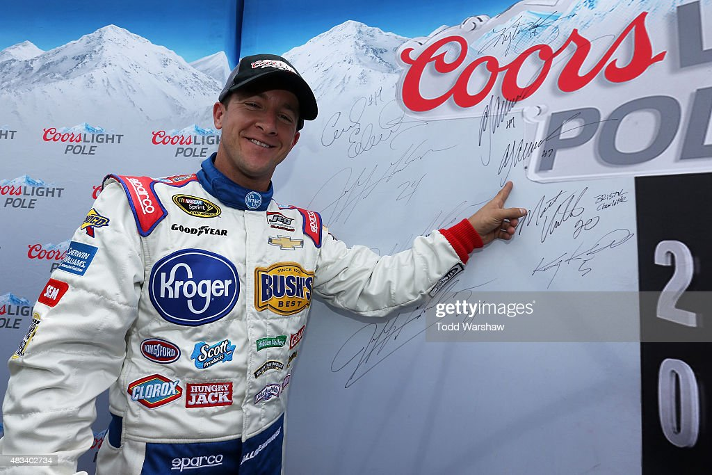 Allmendinger driver of the Kroger/Bush's Beans Chevrolet poses with the Coors Light Pole board after qualifying for the pole position for the NASCAR...