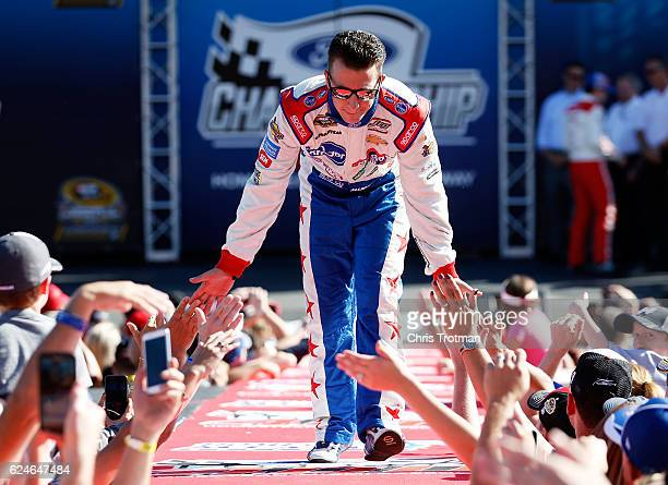 Allmendinger driver of the Kroger/Clorox Chevrolet greets fans as he is introduced prior to the NASCAR Sprint Cup Series Ford EcoBoost 400 at...