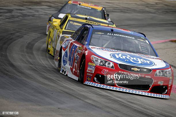 Allmendinger driver of the Kroger/Clorox Chevrolet leads a pack of cars during the NASCAR Sprint Cup Series Goody's Fast Relief 500 at Martinsville...