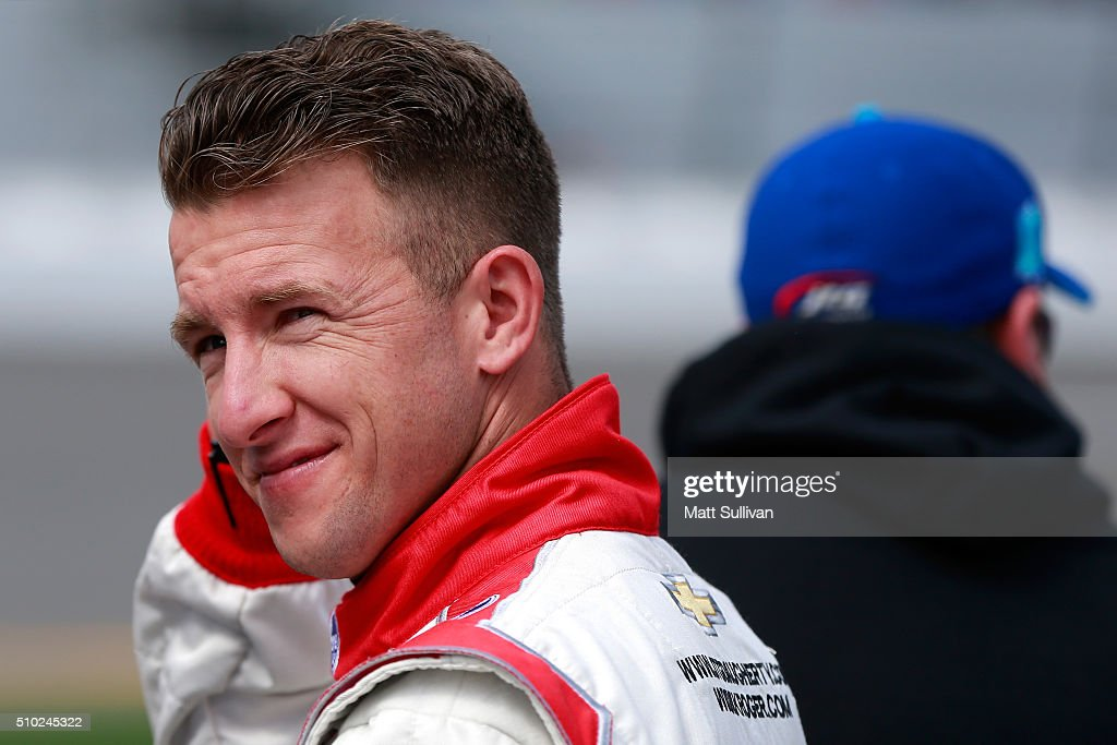 AJ Allmendinger, driver of the #47 Kroger/Scott Products Chevrolet, stands on the grid during qualifying for the NASCAR Sprint Cup Series Daytona 500 at Daytona International Speedway on February 14, 2016 in Daytona Beach, Florida.