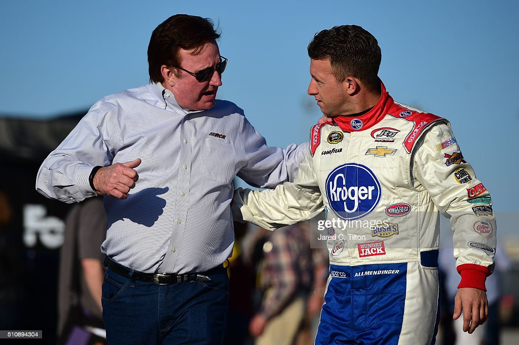 Allmendinger driver of the Kroger/Scott Products Chevrolet talks to team owner Richard Childress in the garage area during practice for the Daytona...