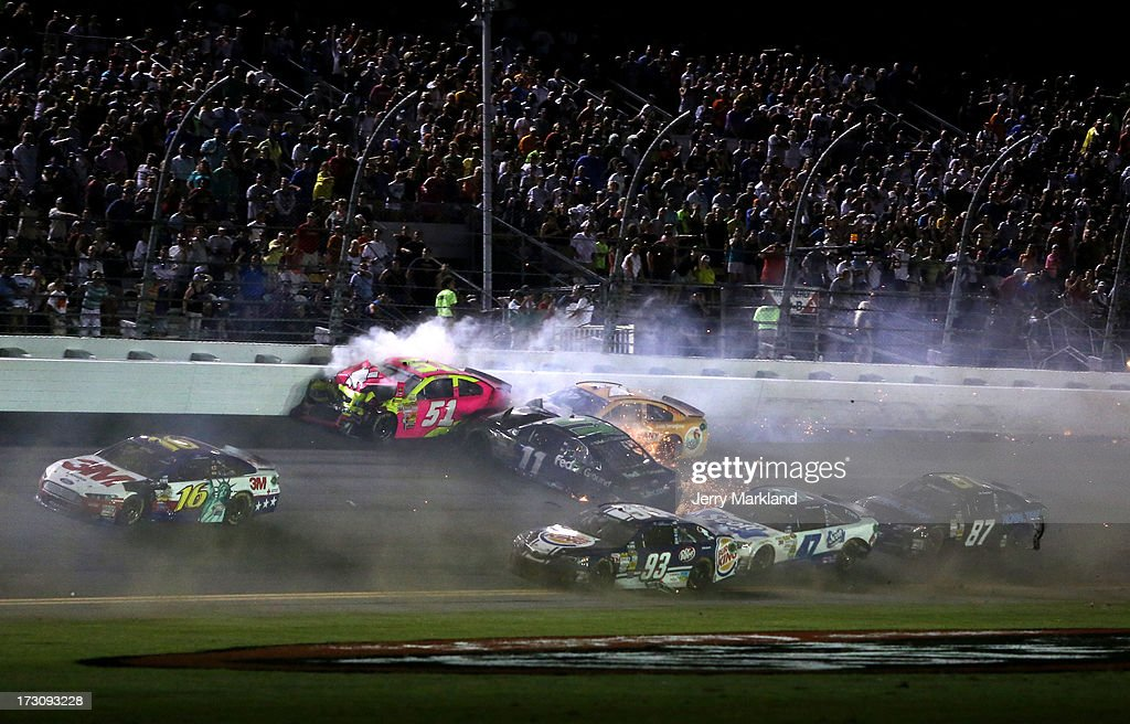 AJ Allmendinger, driver of the #51 Phoenix Construction Chevrolet, and Denny Hamlin, driver of the #11 FedEx Ground Toyota, crash during the NASCAR Sprint Cup Series Coke Zero 400 at Daytona International Speedway on July 6, 2013 in Daytona Beach, Florida.