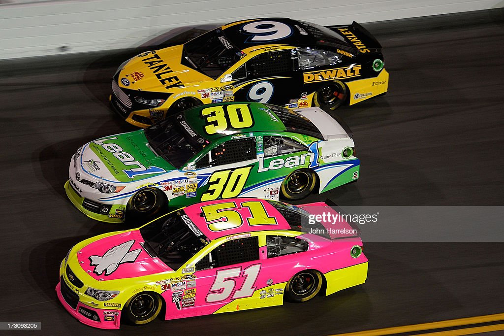 AJ Allmendinger, driver of the #51 Phoenix Construction Chevrolet, races David Stremme, driver of the #30 Lean 1 Toyota, and Marcos Ambrose, driver of the #9 Stanley Ford, during the NASCAR Sprint Cup Series Coke Zero 400 at Daytona International Speedway on July 6, 2013 in Daytona Beach, Florida.