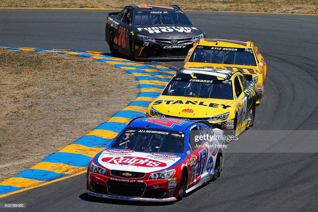 AJ Allmendinger, driver of the #47 Ralph's/Kingsford Chevrolet, leads <a gi-track='captionPersonalityLinkClicked' href=/galleries/search?phrase=Carl+Edwards+-+Racecar+Driver&family=editorial&specificpeople=193803 ng-click='$event.stopPropagation()'>Carl Edwards</a>, driver of the #19 Stanley Toyota, <a gi-track='captionPersonalityLinkClicked' href=/galleries/search?phrase=Kyle+Busch&family=editorial&specificpeople=211123 ng-click='$event.stopPropagation()'>Kyle Busch</a>, driver of the #18 M&M's 75th Anniversary Toyota, and Martin Truex Jr, driver of the #78 Furniture Row Toyota, during the NASCAR Sprint Cup Series Toyota/Save Mart 350 at Sonoma Raceway on June 26, 2016 in Sonoma, California.