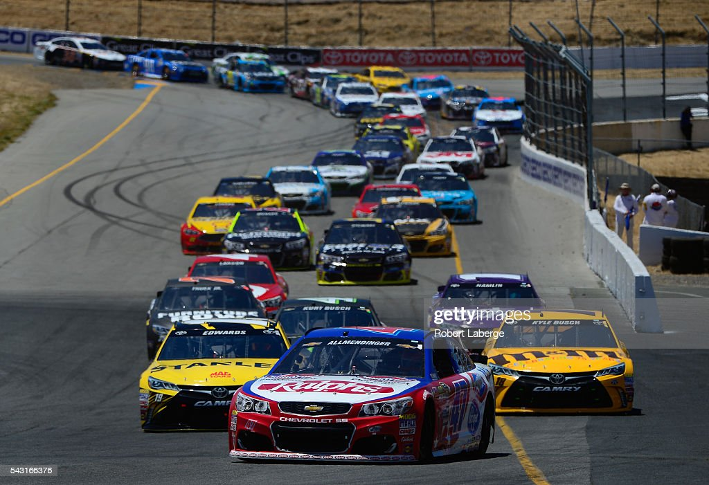 AJ Allmendinger, driver of the #47 Ralph's/Kingsford Chevrolet, leads <a gi-track='captionPersonalityLinkClicked' href=/galleries/search?phrase=Carl+Edwards+-+Racecar+Driver&family=editorial&specificpeople=193803 ng-click='$event.stopPropagation()'>Carl Edwards</a>, driver of the #19 Stanley Toyota, and <a gi-track='captionPersonalityLinkClicked' href=/galleries/search?phrase=Kyle+Busch&family=editorial&specificpeople=211123 ng-click='$event.stopPropagation()'>Kyle Busch</a>, driver of the #18 M&M's 75th Anniversary Toyota, during the NASCAR Sprint Cup Series Toyota/Save Mart 350 at Sonoma Raceway on June 26, 2016 in Sonoma, California.