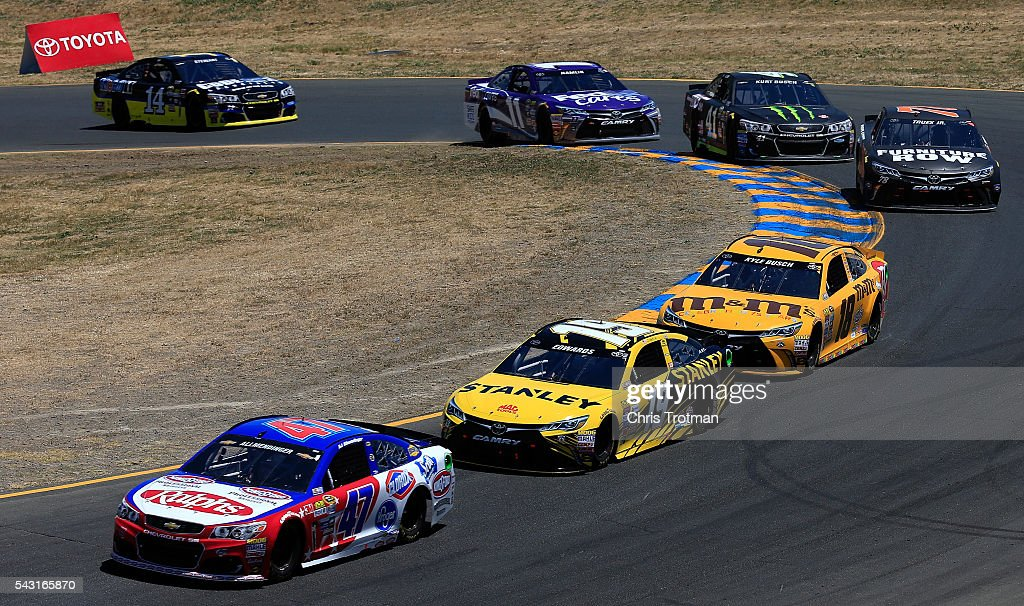 AJ Allmendinger, driver of the #47 Ralph's/Kingsford Chevrolet, races <a gi-track='captionPersonalityLinkClicked' href=/galleries/search?phrase=Carl+Edwards+-+Racecar+Driver&family=editorial&specificpeople=193803 ng-click='$event.stopPropagation()'>Carl Edwards</a>, driver of the #19 Stanley Toyota, and <a gi-track='captionPersonalityLinkClicked' href=/galleries/search?phrase=Kyle+Busch&family=editorial&specificpeople=211123 ng-click='$event.stopPropagation()'>Kyle Busch</a>, driver of the #18 M&M's 75th Anniversary Toyota, during the NASCAR Sprint Cup Series Toyota/Save Mart 350 at Sonoma Raceway on June 26, 2016 in Sonoma, California.