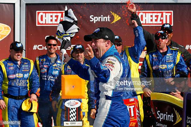 Allmendinger driver of the Scott Products Chevrolet celebrates in Victory Lane after winning the NASCAR Sprint Cup Series CheezIt 355 at Watkins Glen...