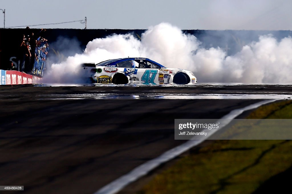 Allmendinger driver of the Scott Products Chevrolet celebrates with a burnout after winning the NASCAR Sprint Cup Series CheezIt 355 at Watkins Glen...