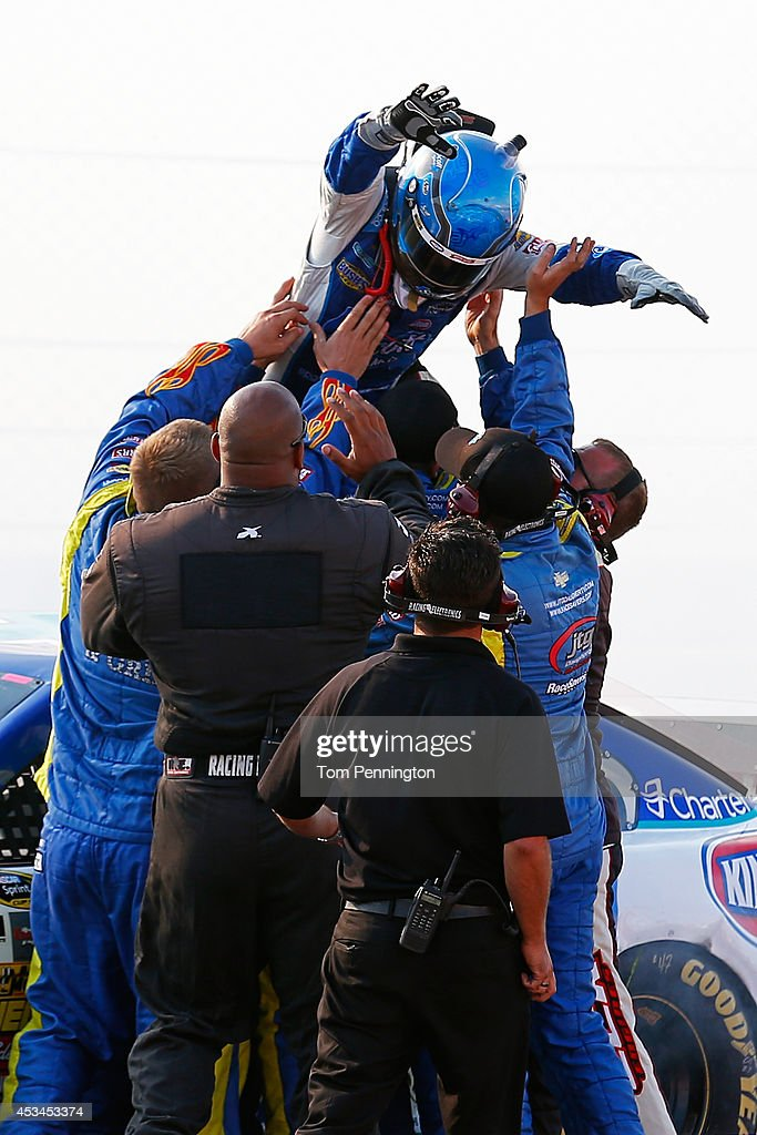 Allmendinger driver of the Scott Products Chevrolet celebrates with his crew after winning the NASCAR Sprint Cup Series CheezIt 355 at Watkins Glen...