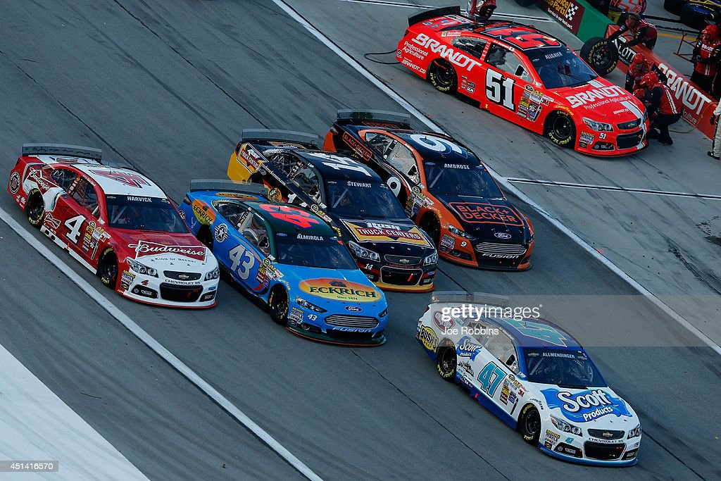 AJ Allmendinger, driver of the #47 Scott Products Chevrolet, <a gi-track='captionPersonalityLinkClicked' href=/galleries/search?phrase=Kevin+Harvick&family=editorial&specificpeople=209186 ng-click='$event.stopPropagation()'>Kevin Harvick</a>, driver of the #4 Budweiser Chevrolet, <a gi-track='captionPersonalityLinkClicked' href=/galleries/search?phrase=Aric+Almirola&family=editorial&specificpeople=574878 ng-click='$event.stopPropagation()'>Aric Almirola</a>, driver of the #43 Eckrich Ford, <a gi-track='captionPersonalityLinkClicked' href=/galleries/search?phrase=Tony+Stewart+-+Pilota+automobilistico&family=editorial&specificpeople=201686 ng-click='$event.stopPropagation()'>Tony Stewart</a>, driver of the #14 Rush Truck Centers Chevrolet, and <a gi-track='captionPersonalityLinkClicked' href=/galleries/search?phrase=Marcos+Ambrose&family=editorial&specificpeople=179434 ng-click='$event.stopPropagation()'>Marcos Ambrose</a>, driver of the #9 Black & Decker Ford, race off pit road during the NASCAR Sprint Cup Series Quaker State 400 presented by Advance Auto Parts at Kentucky Speedway on June 28, 2014 in Sparta, Kentucky.