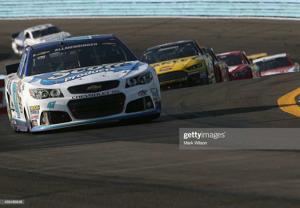 AJ Allmendinger, driver of the #47 Scott Products Chevrolet, leads a pack of cars the NASCAR Sprint Cup Series Cheez-It 355 at Watkins Glen International on August 10, 2014 in Watkins Glen, New York.