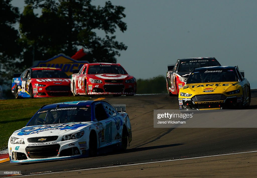 AJ Allmendinger, driver of the #47 Scott Products Chevrolet, leads a pack of cars during the NASCAR Sprint Cup Series Cheez-It 355 at Watkins Glen International on August 10, 2014 in Watkins Glen, New York.