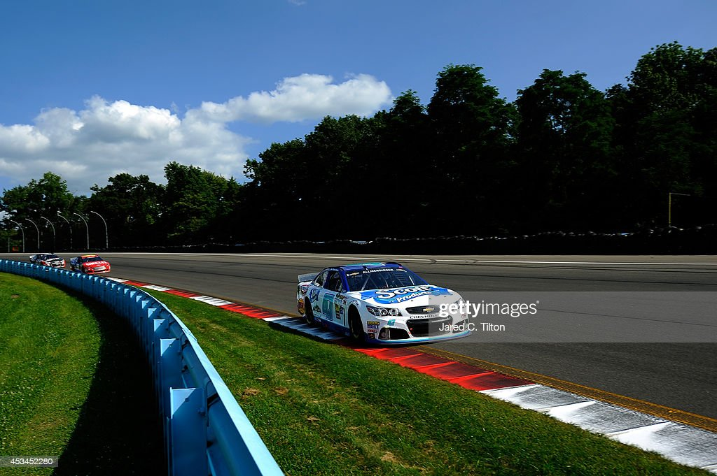 Allmendinger driver of the Scott Products Chevrolet leads a pack of cars during the NASCAR Sprint Cup Series CheezIt 355 at Watkins Glen...
