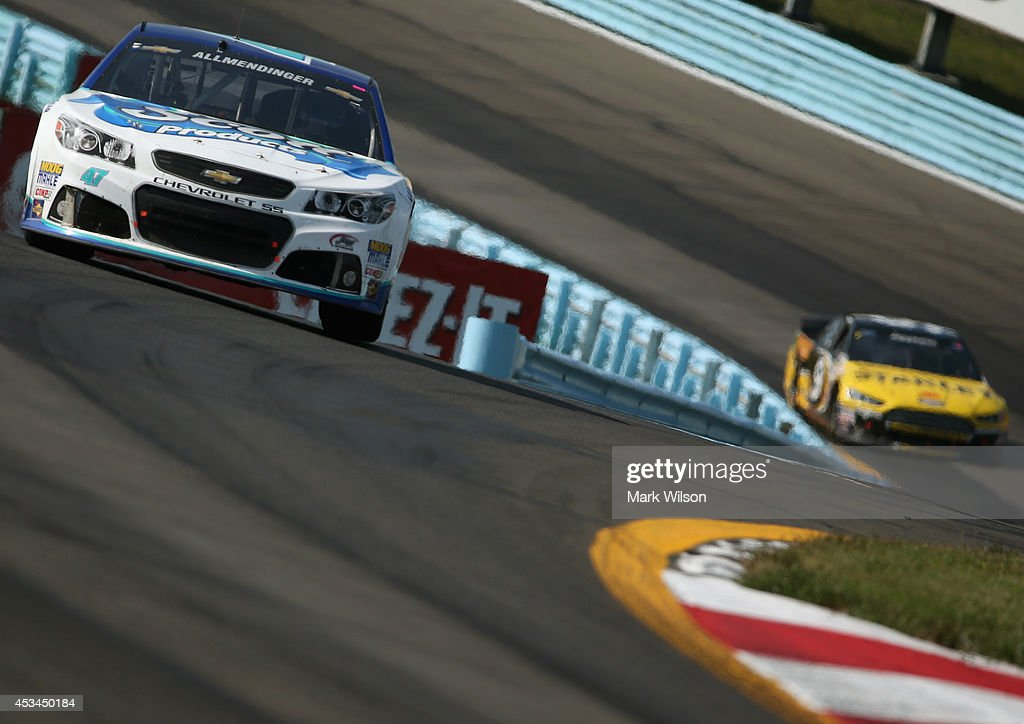 AJ Allmendinger, driver of the #47 Scott Products Chevrolet, leads Marcos Ambrose, driver of the #9 Stanley Ford, during the NASCAR Sprint Cup Series Cheez-It 355 at Watkins Glen International on August 10, 2014 in Watkins Glen, New York.