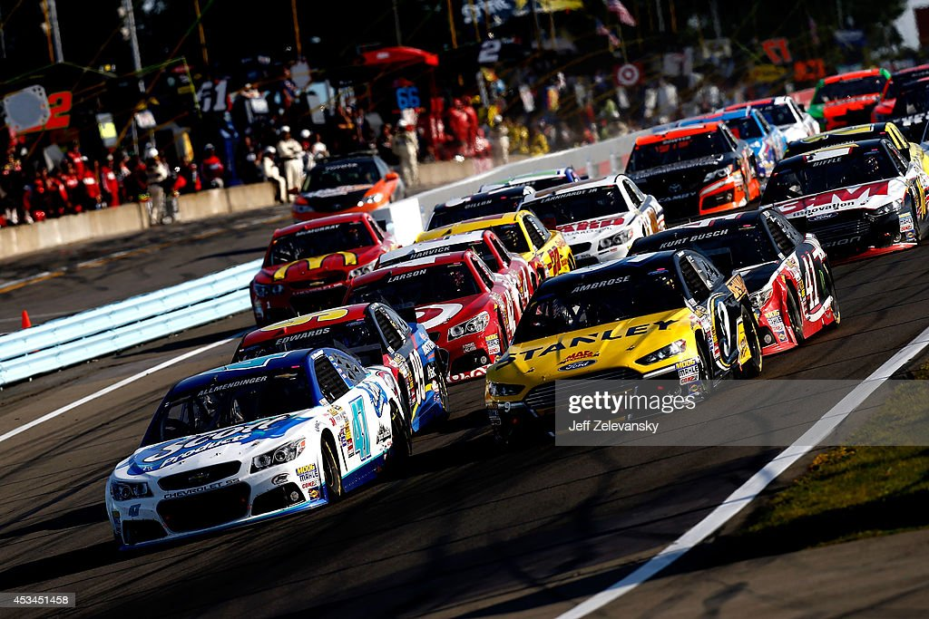 Allmendinger driver of the Scott Products Chevrolet leads the field on the final restart during the NASCAR Sprint Cup Series CheezIt 355 at Watkins...