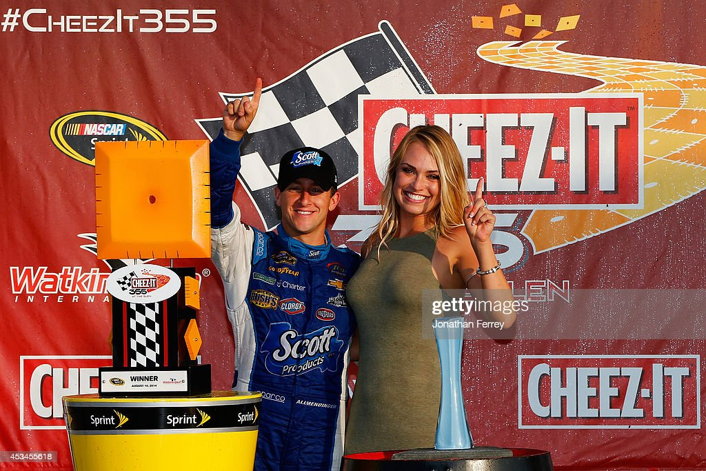 Allmendinger driver of the Scott Products Chevrolet poses with girlfriend Tara Lea in Victory Lane after winning the NASCAR Sprint Cup Series CheezIt...