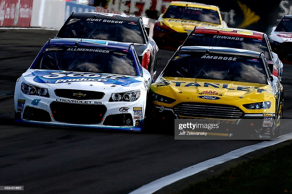 AJ Allmendinger, driver of the #47 Scott Products Chevrolet, races Marcos Ambrose, driver of the #9 Stanley Ford, during the NASCAR Sprint Cup Series Cheez-It 355 at Watkins Glen International on August 10, 2014 in Watkins Glen, New York.