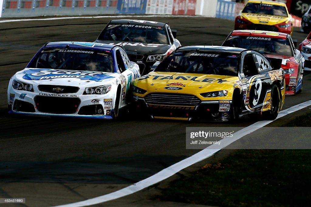 Allmendinger driver of the Scott Products Chevrolet races Marcos Ambrose driver of the Stanley Ford during the NASCAR Sprint Cup Series CheezIt 355...