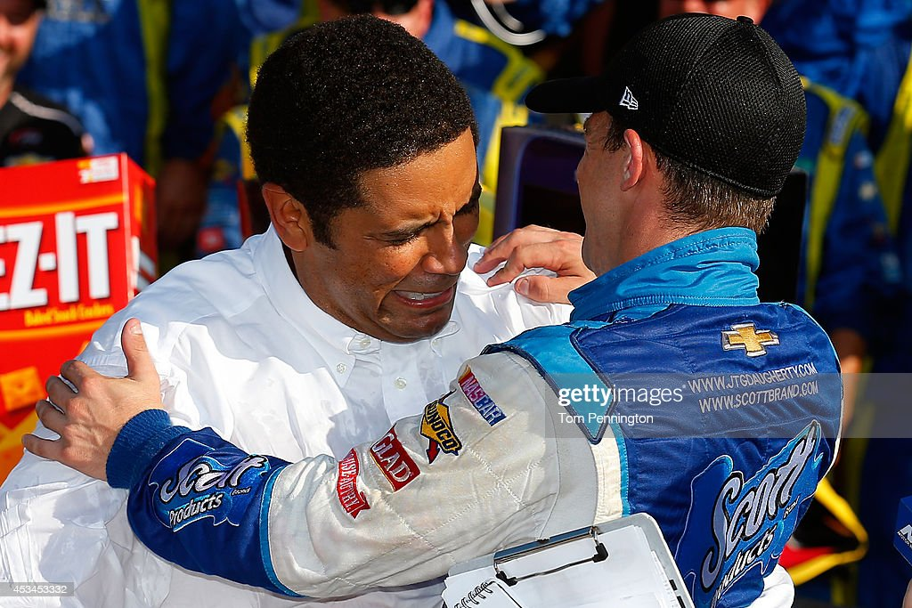 Allmendinger driver of the Scott Products Chevrolet right celebrates with team owner Brad Daugherty in Victory Lane after winning the NASCAR Sprint...