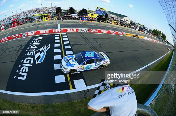 Allmendinger driver of the Scott Products Chevrolet takes the checkered flag to win the NASCAR Sprint Cup Series CheezIt 355 at Watkins Glen...