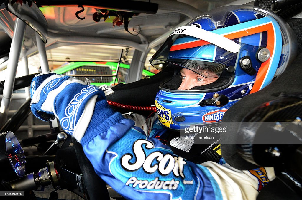 AJ Allmendinger, driver of the #47 Scott Products Toyota, sits in his car during practice for the NASCAR Sprint Cup Series AdvoCare 500 at Atlanta Motor Speedway on August 31, 2013 in Hampton, Georgia.