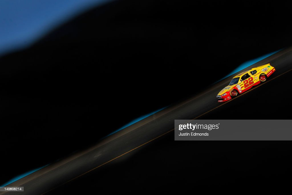 J Allmendinger driver of the Shell Pennzoil Dodge drives during practice for the NASCAR Sprint Cup Series Subway Fresh Fit 500 at Phoenix...