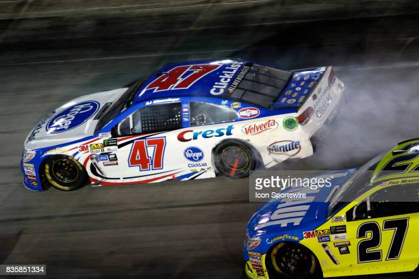J Allmendinger JTG/Daughtery Racing Kroger ClickList Chevrolet SS during the running of the 57th annual Bass Pro Shops NRA Night Race 500 on August...