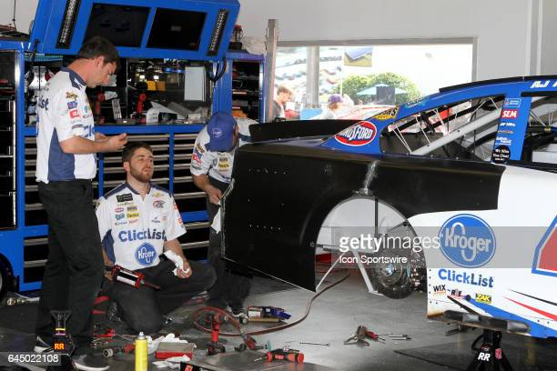 J Allmendinger's crew repairs damage from last night's CanAm Duel race in the garage during practice for the NASCAR Monster Energy Cup Series Daytona...