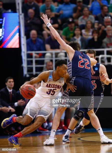 Allonzo Trier of Arizona drives around Dane Pineau of St Mary's during the 2017 NCAA Men's Basketball Tournament held at Vivint Smart Home Arena on...