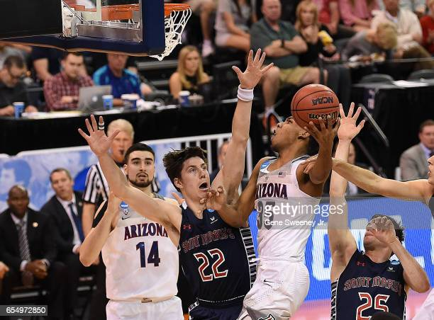 Allonzo Trier of the Arizona Wildcats attempts a shot defended by Dane Pineau of the St Mary's Gaels during the second round of the 2017 NCAA Men's...