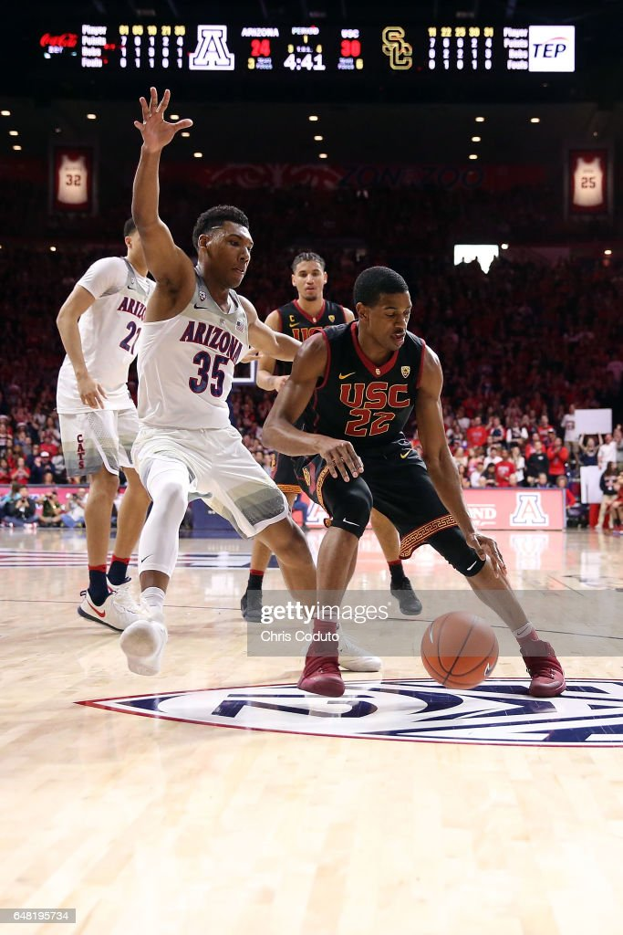 Allonzo Trier #35 of the Arizona Wildcats defends De'Anthony Melton #22 of the USC Trojans during the first half of the college basketball game at McKale Center on February 23, 2017 in Tucson, Arizona. Arizona beat USC