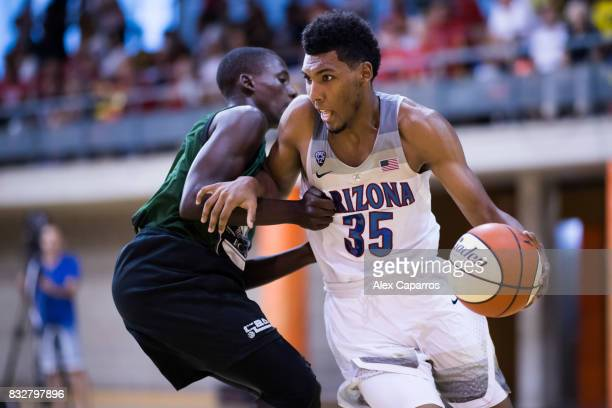 Allonzo Trier of the Arizona Wildcats dribbles Sigu of the Mataro AllStars during the Arizona In Espana Foreign Tour game between Mataro AllStars and...