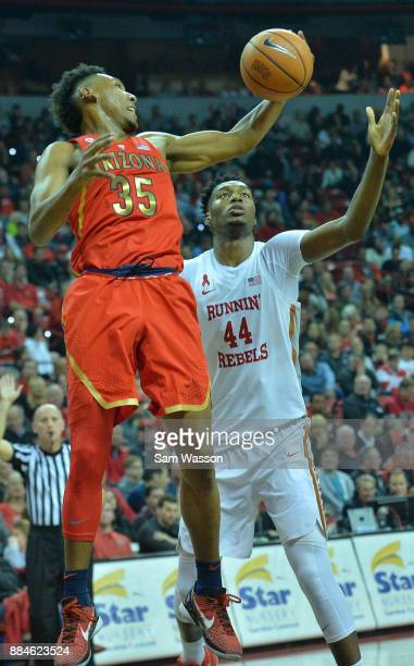 Allonzo Trier of the Arizona Wildcats grabs a rebound against Brandon McCoy of the UNLV Rebels during their game at the Thomas Mack Center on...